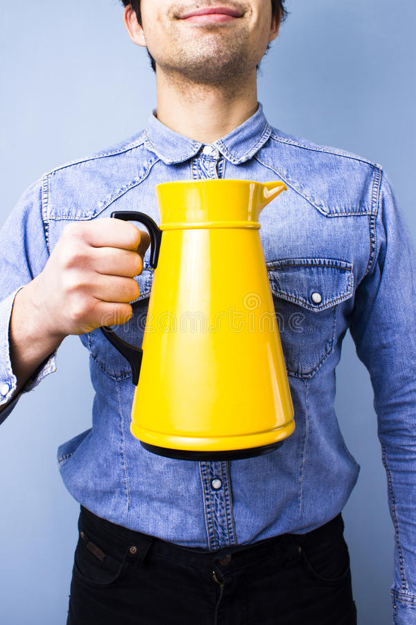 Download Happy Ethnic Man Holding A Jug Stock Photo - Image: 31150022