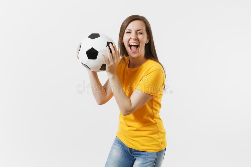 Happy European young woman, football fan or player in yellow uniform holding soccer ball support favorite team isolated royalty free stock photos