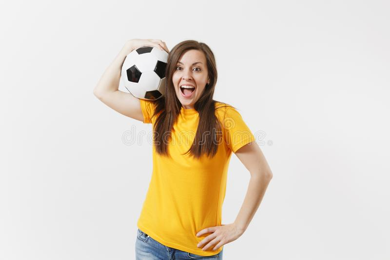 Happy European young woman, football fan or player in yellow uniform holding soccer ball support favorite team isolated. On white background. Sport, play stock photo