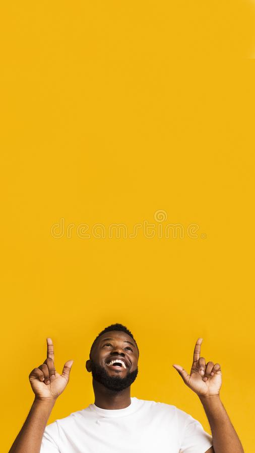 Happy excited african american man pointing at empty space royalty free stock photos