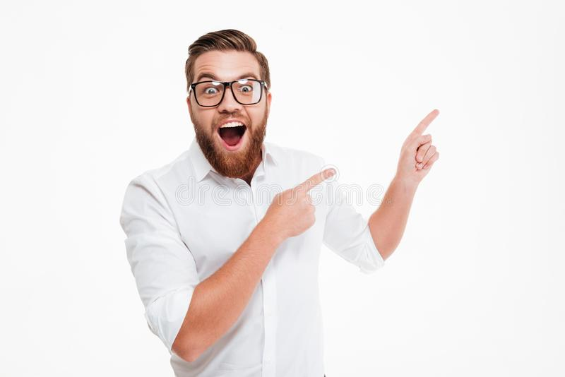 Happy excited bearded man in eyeglasses royalty free stock images