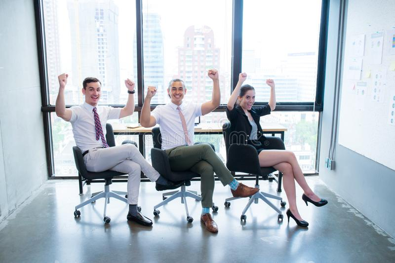 Happy excited business teamwork celebrating victory. Raising hand, success concept stock photo