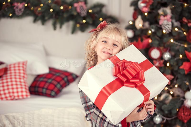 Happy excited girl child holding christmas gift box royalty free stock photo