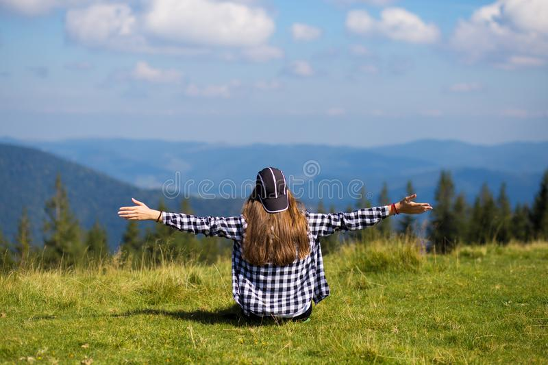 Happy excited girl with hands up looking at amazing view royalty free stock photo