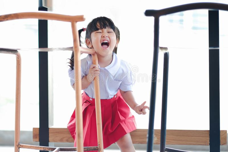 Happy and Excited Kids. Portrait of a Three Years old Girl in Student Uniform. Happiness Moment, Laughing stock photo