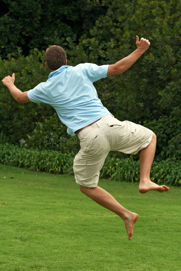 Happy, excited man, jumping in air royalty free stock images
