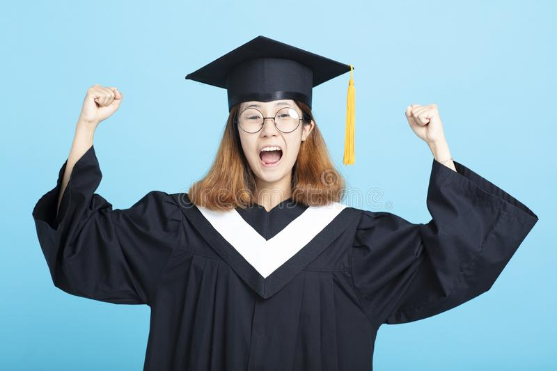 Happy and excited success graduation girl stock image