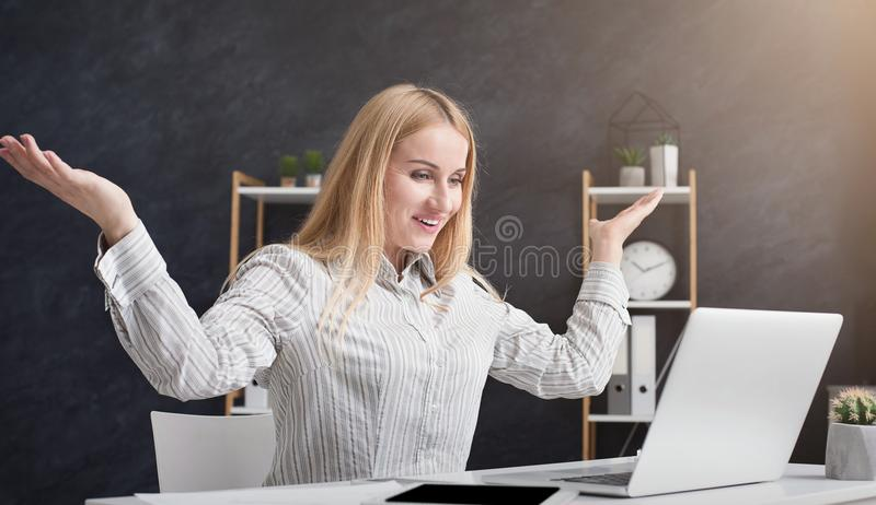Happy excited successful businesswoman triumphing in office royalty free stock photo
