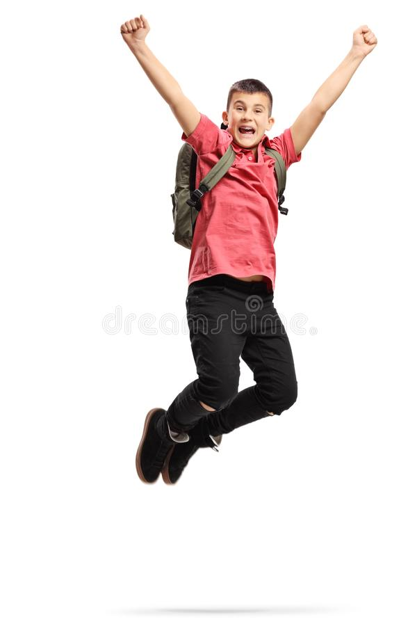 Happy and excited teenage schoolboy jumping. Full length portrait shot of a happy and excited teenage schoolboy jumping isolated on white background royalty free stock photography