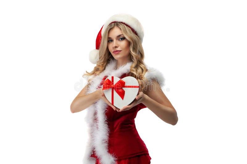 Happy excited young woman in santa claus hat with gift box over white background. stock images