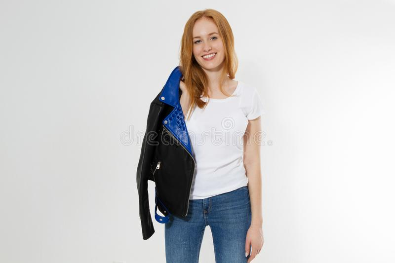 Happy Excited Young Woman in white t shirt and black leather jacket isolated on white background. Red hair girl in fashion clothes stock photo