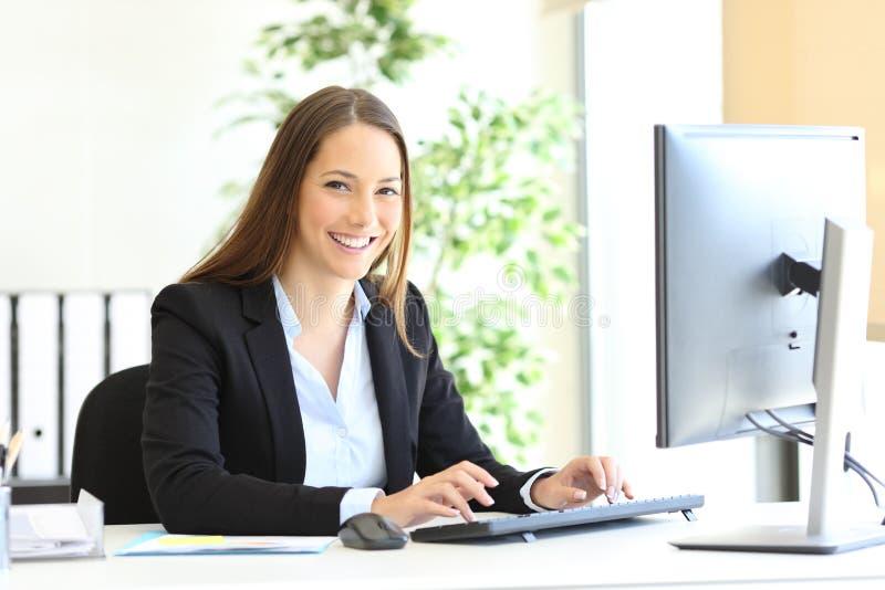 Happy executive looks at camera at office royalty free stock photo