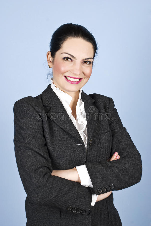 Happy Executive Woman With Arms Folded Royalty Free Stock Images