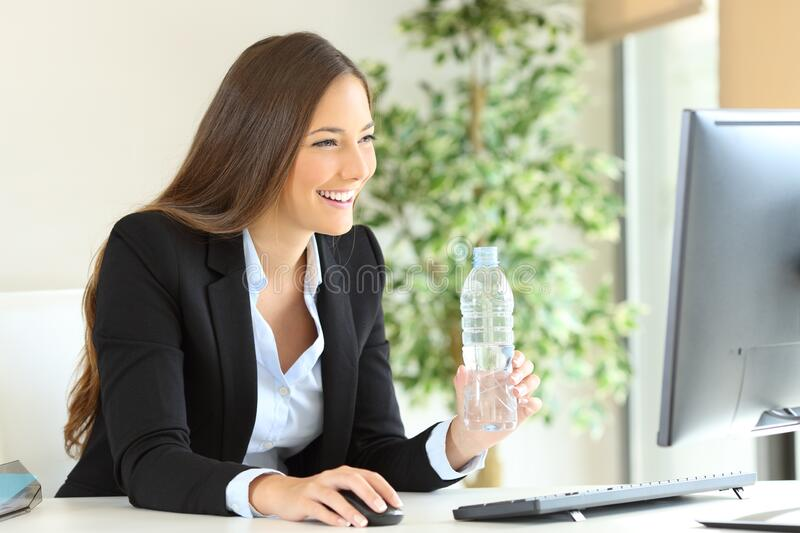 Happy executive working holding a bottle of water royalty free stock photos
