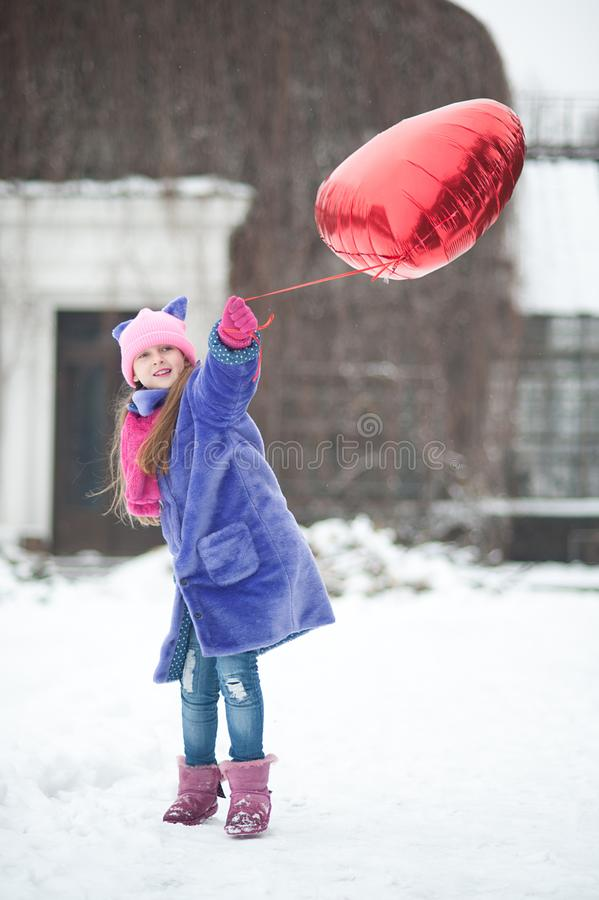 Happy exited girl with Valentine heart balloons outdoor. Valentine`s day concept. Copy space. royalty free stock photos
