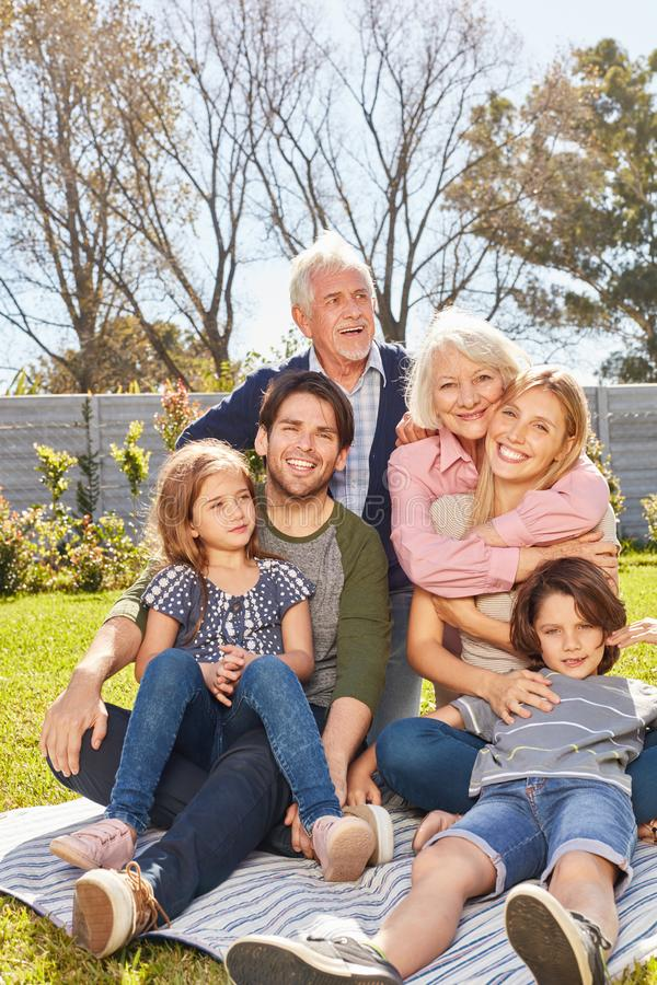 Happy extended family with children and grandparents stock photo