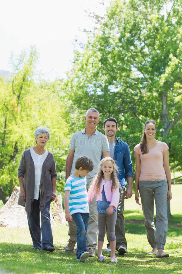 Happy extended family walking in park royalty free stock image