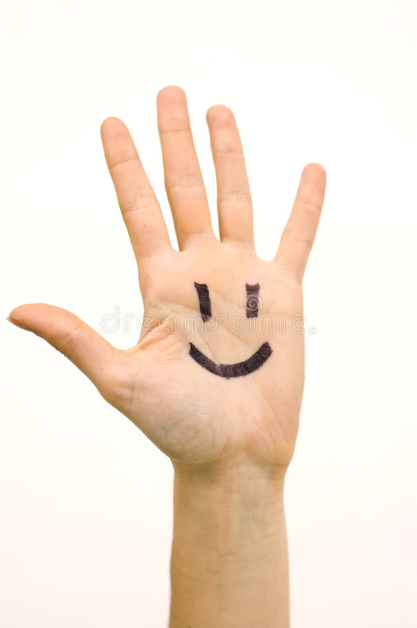 Happy face. Drawn in a open hand royalty free stock photography