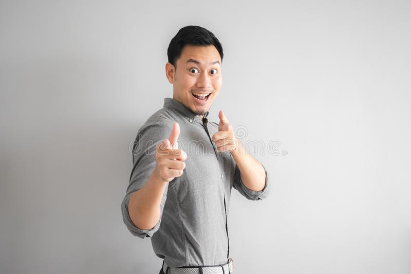 Happy face of funny good looking man with hand sign pointing stock images