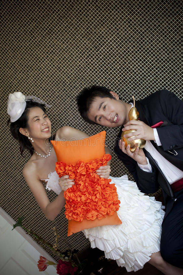 Happy face of groom and bride in wedding suit at home royalty free stock photo