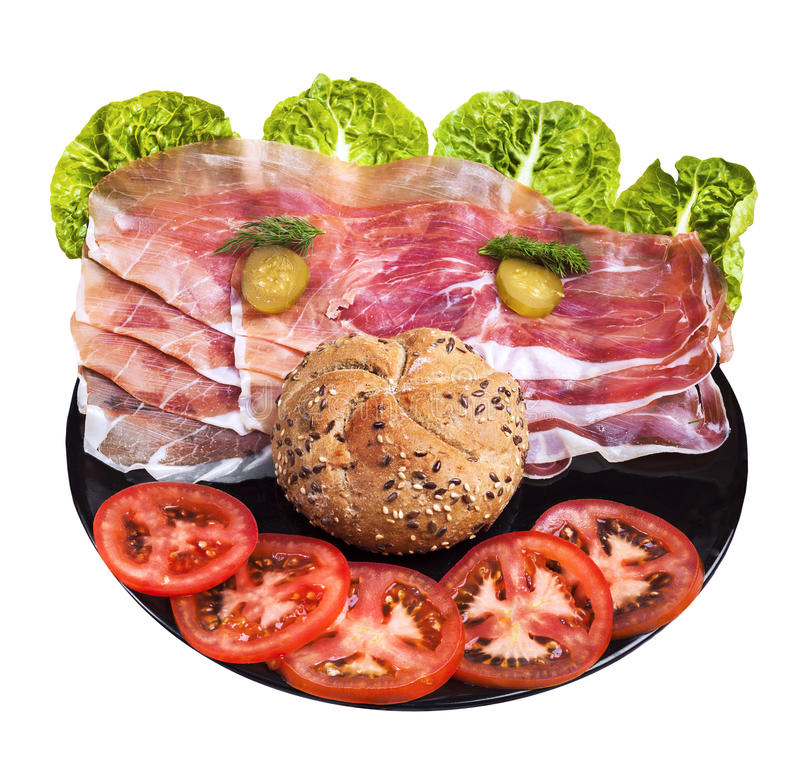 Happy face made of food. Happy face made of vegetables, ham and bread roll stock images