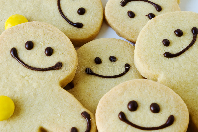 Happy faces. Shortbread men happy to be together royalty free stock photos
