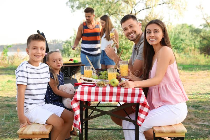 Happy families with little children having picnic royalty free stock photo