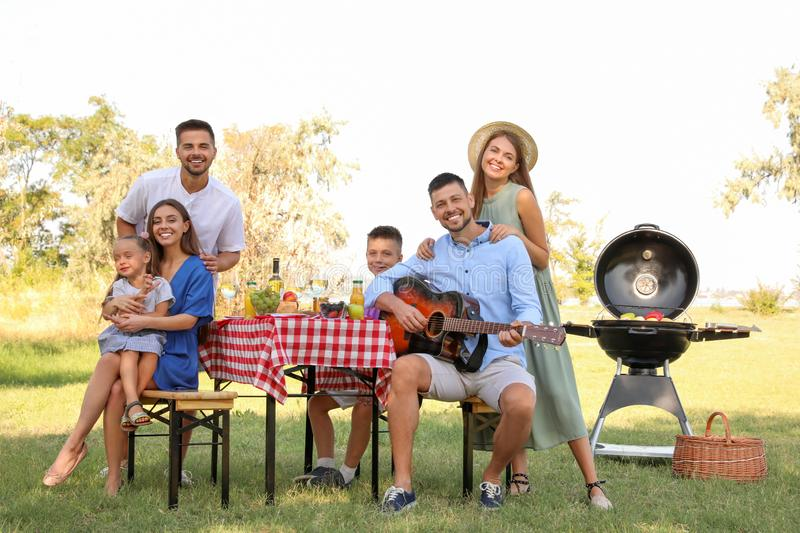 Happy families with little children having  in park royalty free stock photos