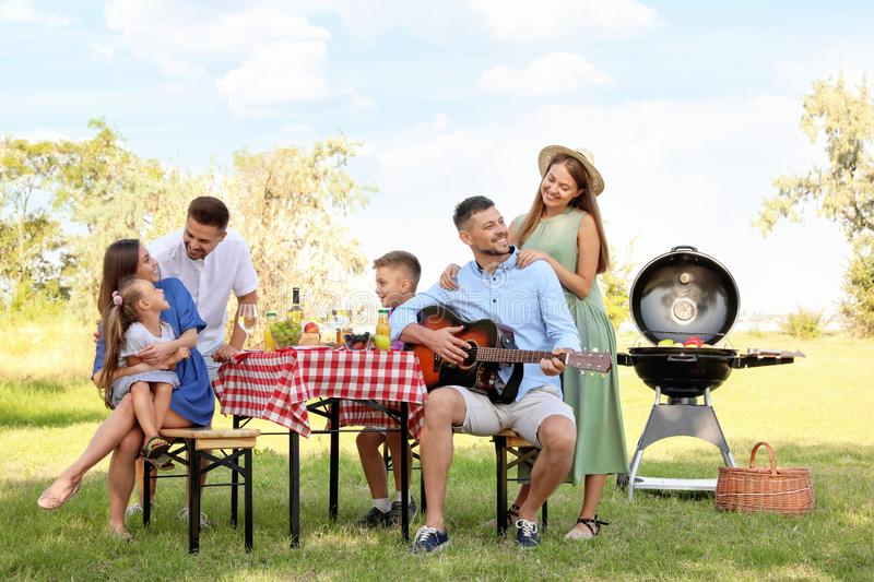 Happy families with little children having picnic royalty free stock image