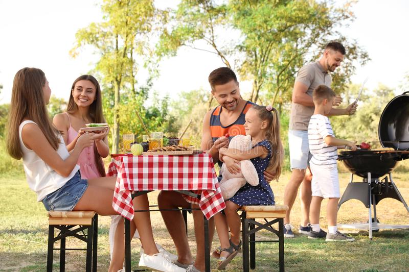 Happy families with little children having picnic stock photo