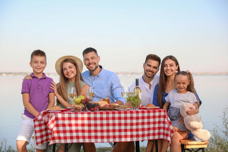 Happy families with little children at picnic table royalty free stock image