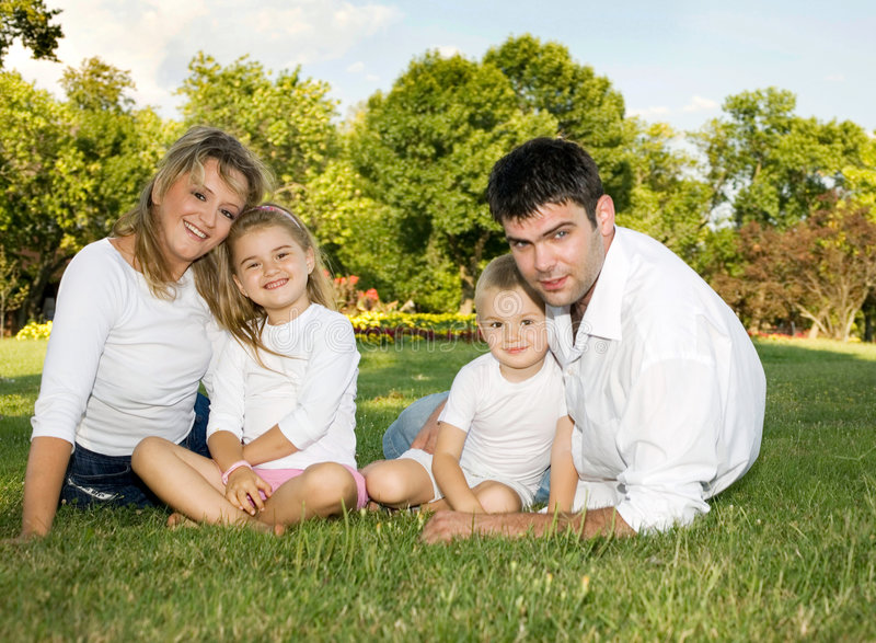 Happy familly. Family on a sunny day at the park royalty free stock photo