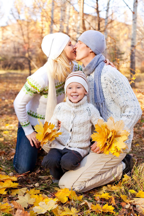 Happy family. Happy young family spending time outdoor in the park stock photos