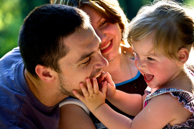 Happy family. Joy, father, mother and doghter