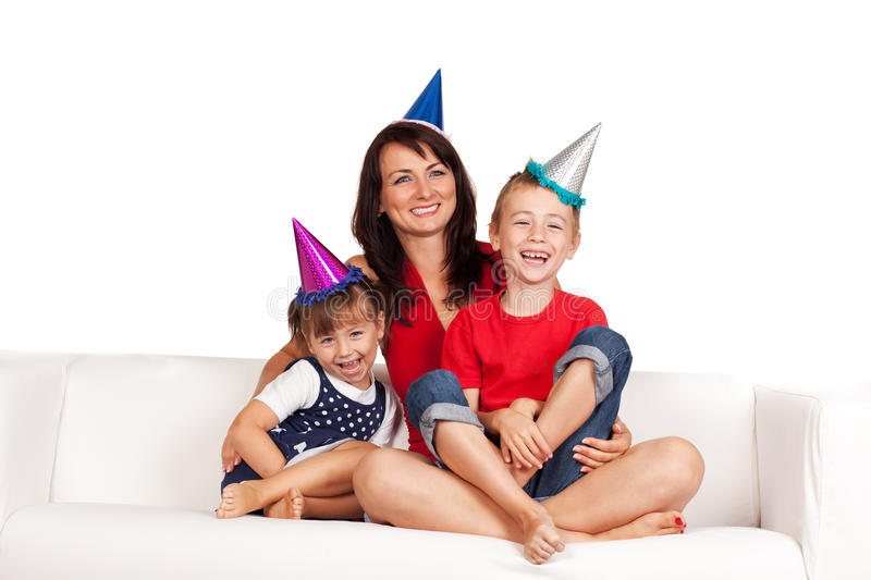 Happy family. Mother and children celebrating birthday at home stock photos