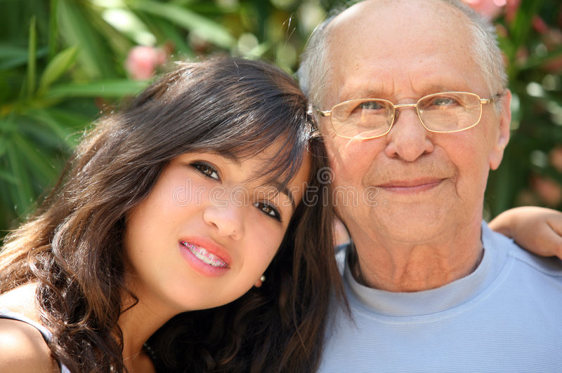Happy family. Young pretty woman and her grandfather stock images