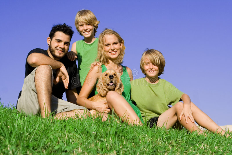 Happy family. Happy smiling young family group with pet dog