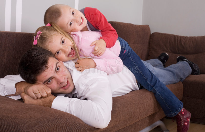 Happy family. Father and children playing at the house royalty free stock image