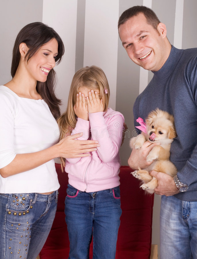 Happy family. Young happy family, gift for little girls birthday stock photo