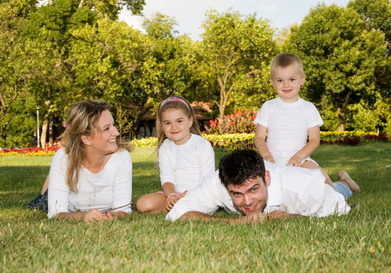 Happy family. Young happy family at the park stock photo