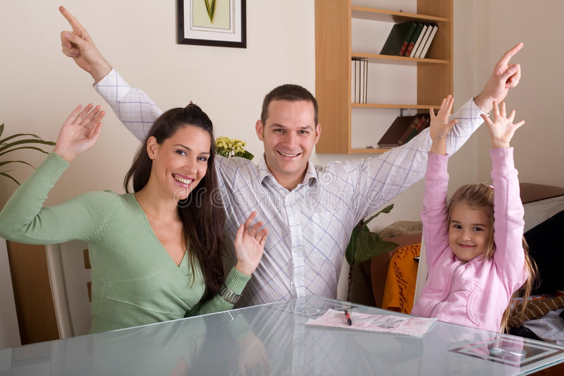 Happy family. Celebrating and waving stock image