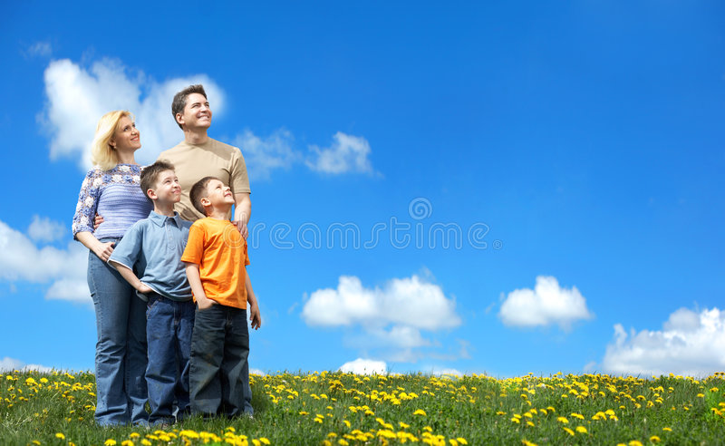 Happy family. Family undr blue sky. Father, mother and sons in the park