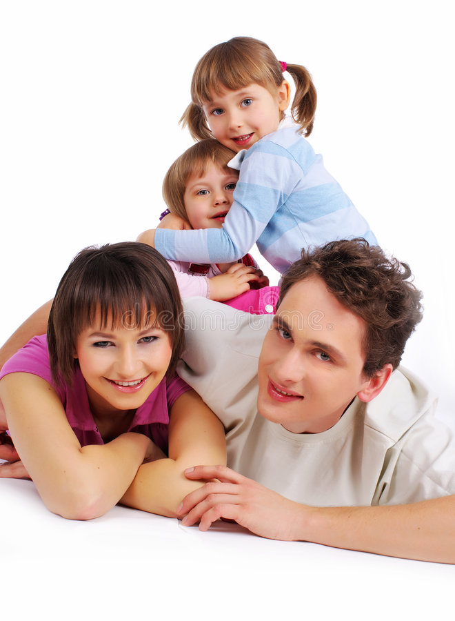 Happy family. Portrait of a attractive young family smiling a break and relaxing royalty free stock photography
