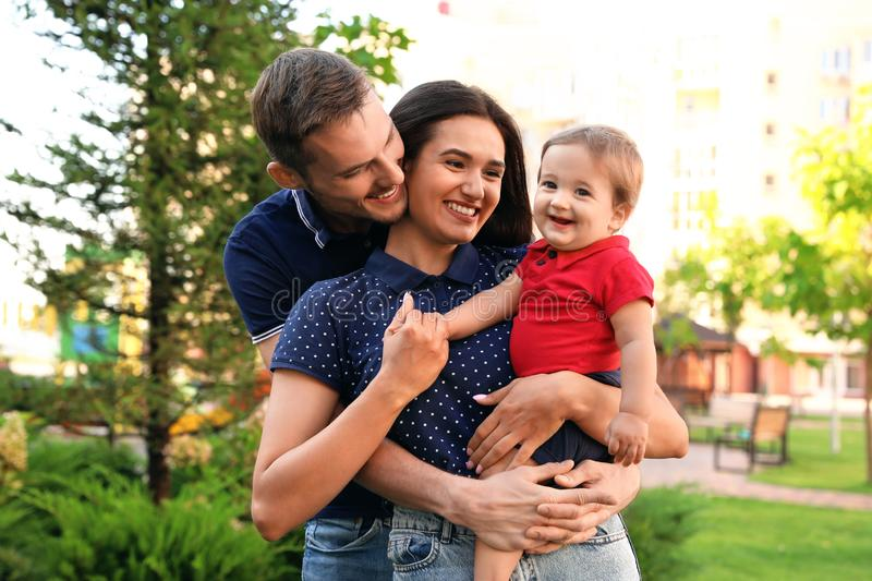 Happy family with adorable little baby royalty free stock photos