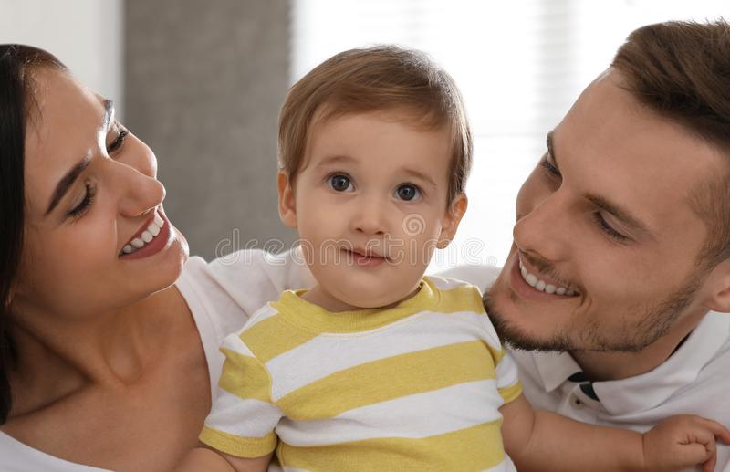 Happy family with adorable little baby at royalty free stock photo