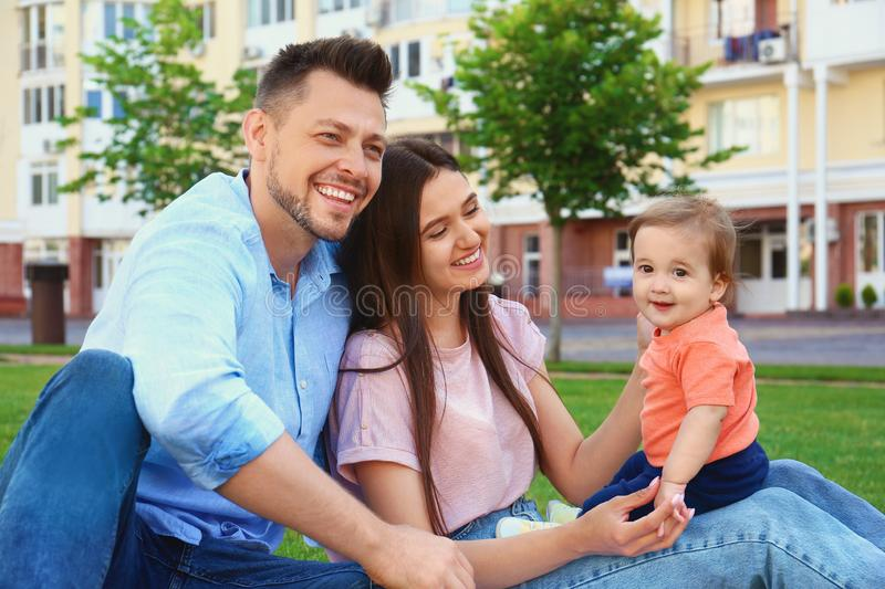 Happy family with adorable little baby royalty free stock images