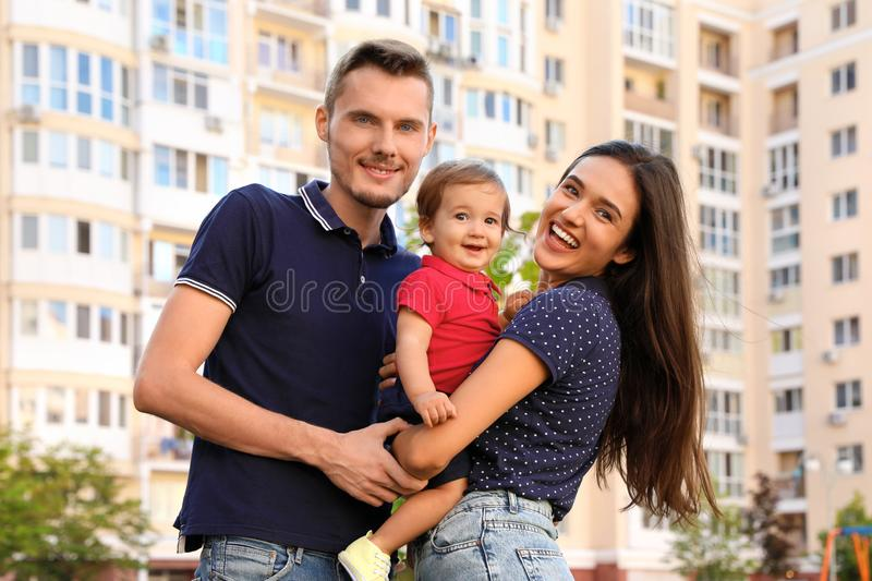 Happy family with adorable little baby. Outdoors royalty free stock image