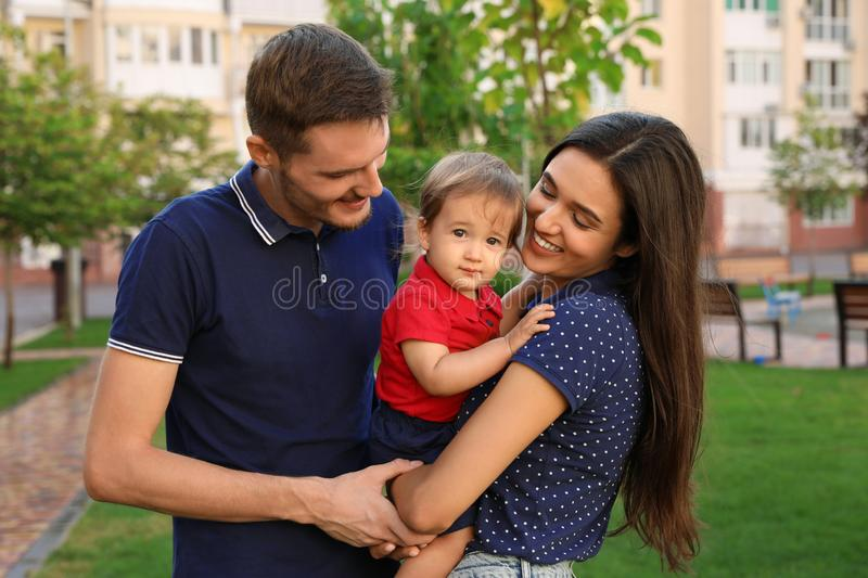 Happy family with adorable little baby. Outdoors royalty free stock images