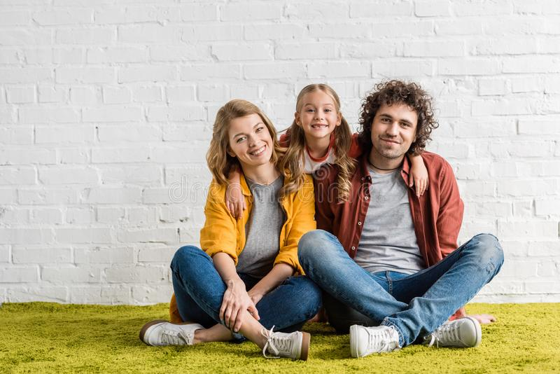 happy family with adorable little child royalty free stock photography