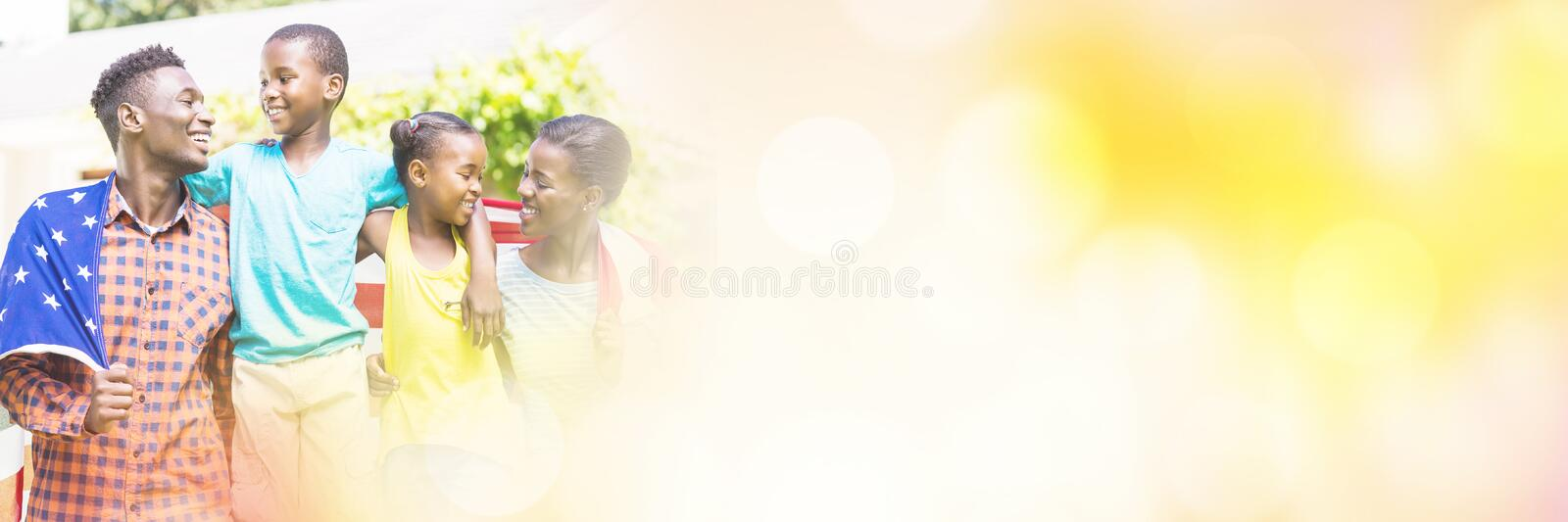 Happy family with American flag on sunny day. At park stock photography